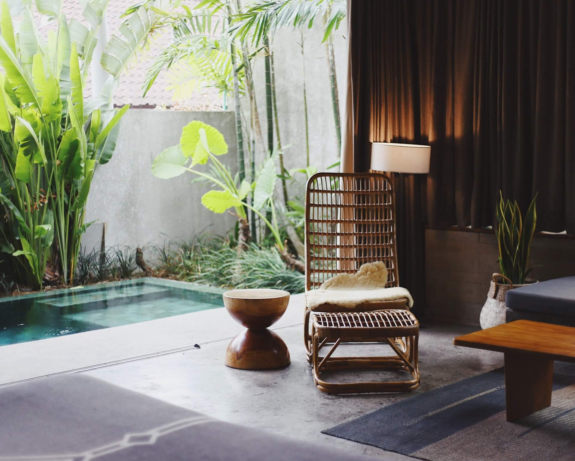 Minimal hotel suite with private pool and flora