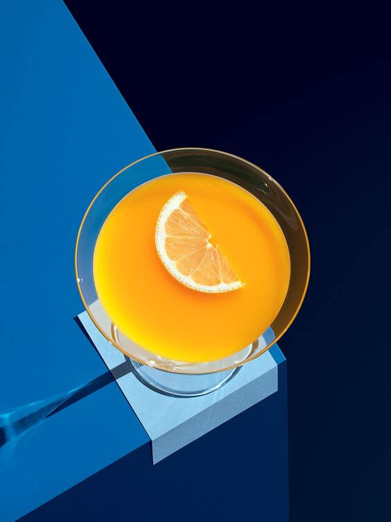 blue table and orange cocktail