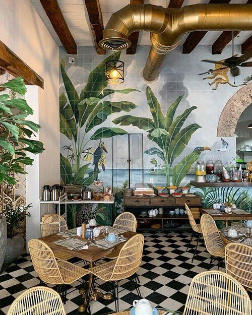 floral walls and wooden chairs